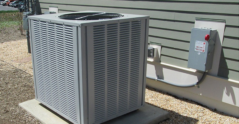 Image of HVAC unit outside family home.